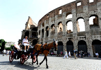 Horse-drawn carriage in front of the Colosseum in Rome, Italy.July 1, 2012