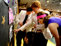 Andy Flanigan, Tim McElroy, Carli Still, and Kelsie Henry look at senior collages.[final1]