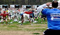 Rick Coe, foreground, leads runners in warm-up excercises before the start of the 27th annual Parkway Classic at the Mt. Vernon estate in April 10, 2011.