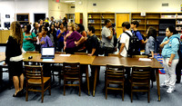 Students, parents and administrators recite the Pledge of Allegiance at Carl Sandburg Middle School on September 6, 2011.
