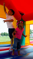 Govanni Hinestroza, 6, left and Kanlya Banks, 3, both of Newport News, play in the moonbounce at the East End Community Day festival.