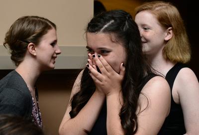 Alex's friend expresses her joy at seeing Alex in her dress.