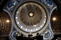 A view up at the main dome in St. Peter's Basilica in the Vatican City. The top of the baldacchino, designed by Bernini, is visible at the bottom.July 3, 2012