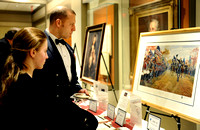 "Kelsey Johnson, left, and her father Lt. Col. Greg Johnson look at a painting titled ""Washington at Carlisle,"" part of a silent auction, at the 64th Annual George Washington Birthnight Supper and Ball"