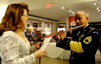 Anne Shingler, left, greets SFC Don Francisco before rehearsing for their performance later in the night at the 64th Annual George Washington Birthnight Supper and Ball at the Mount Vernon Inn on Febr