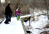 A family looks for animal tracks at Huntley Meadows Park on January 29, 2011.
