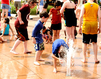 Kids cool off with water jets at the Norfolk Harborfest.