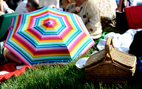 "A picnic basket and an umbrella at the Filene Center lawn before a live broadcast of ""A Prairie Home Companion"" at Wolf Trap on May 28, 2011. Patrons are encouraged to bring food before shows."