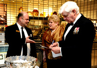 Steve Stuart, left, speaks with Monica Rocchio while Sam Brown, right, fills out raffle tickets during the 64th Annual George Washington Birthnight Supper and Ball at the Mount Vernon Inn on February