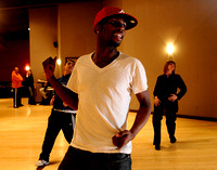 Frankie Humphrey, center, leads Roberto Cabero, left, and Joyce Bradford, right, in a hip hop dance class at Studio B Dance Center in Columbia, MO, on November 17, 2009.