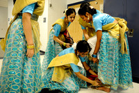 Members of the Jhanak Dance Academy help Nishi Begum, right, attach ghungroos, small bells on strings, before the Cultural Celebration and 12th Annual Step Competition at West Potomac High School on F
