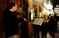 Michael Francis Haley plays the violin along King Street during First Night Alexandria on December 31, 2010.