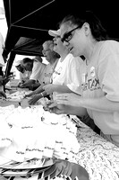 IRENE ROJAS/MissourianAt the FairTax Rally, Alice Forker, left, Kim Lockwood and Erin Dunn sell related apparel.