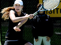 Freshman Danielle Day finishes a forehand during Missouri's match against the University of Colorado Buffaloes at Green Tennis Center on April 11, 2009.