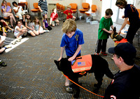 Marshall Thorne, center, pets Sirius Black while Jack Guthrie, back right, pets Jutka Terris' dog Juno after a search and rescue dog demonstration at Martha Washington Library on April 20, 2011. Unlik