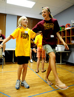 IRENE ROJAS/MissourianKatherine Dudley, 9, left, and volunteer Ashleigh Robertson practice a dance for an upcoming contest at the The Quest Kids Club Vacation Bible School at The Crossing Church on Ju