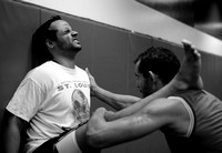 Jose Arias, left, grimmaces as Lucas Lopes helps him stretch at the American Top Team mixed martial arts studio on February 18, 2009.  Lopes moved to Columbia from Brazil two months ago.  Momentarily