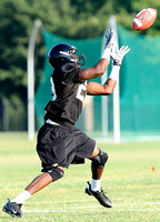 IRENE ROJAS/MissourianFreshman wide receiver Jerrell Jackson catches a football during practice on Saturday, August 8, 2009.
