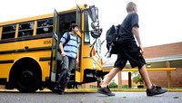 Students unload from buses at Carl Sandburg Middle School on September 6, 2011.
