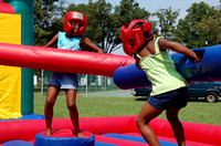 Tajae, 7, left, and Mariah Wiggins, 5, of Newport News, spar each other at the East End Community Day on Saturday September 9 at King Lincoln Park.